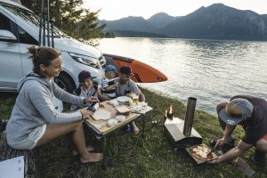 Family enjoying camping and stand up paddling ©JP Australia/Paddle Sports SHow