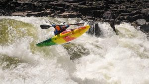 Bren Orton paddles his Pyranha Ripper half slice kayak on the Zambezi river in Africa.